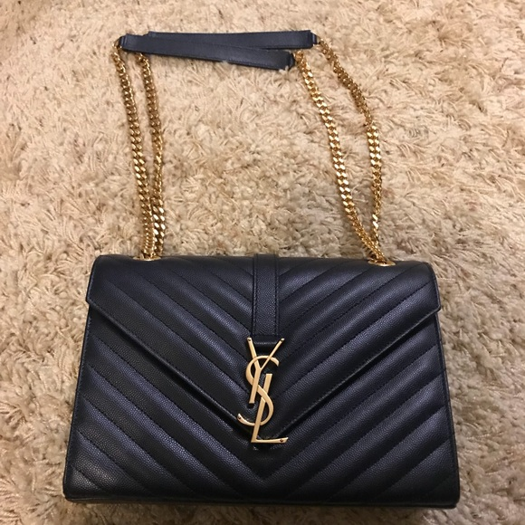 ysl small envelope wallet review